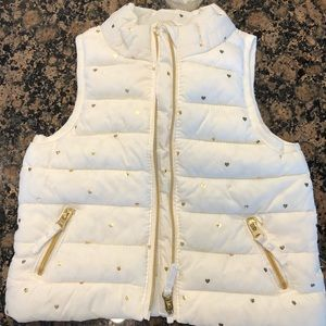 Puffy vest with gold hearts